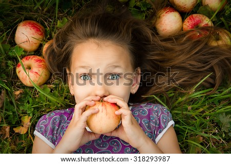 Girl with apples. emotions - stock photo