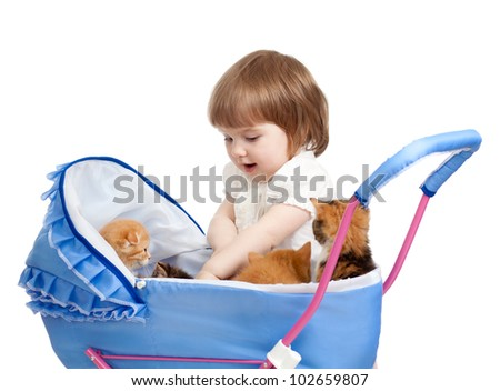 girl with baby carriage and kittens inside - stock photo