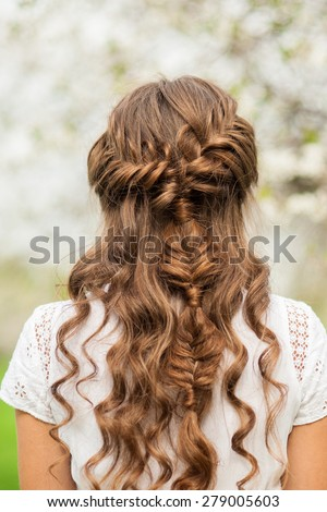 Girl with beautiful  braid hairstyle, rear view - stock photo