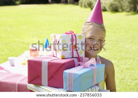 Girl with Birthday Gifts - stock photo