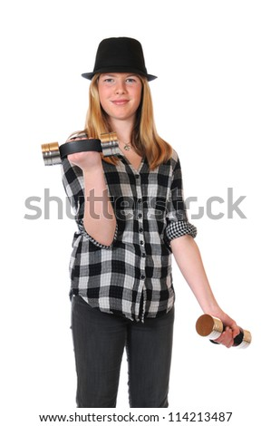 Girl with black hat and dumbbells - stock photo