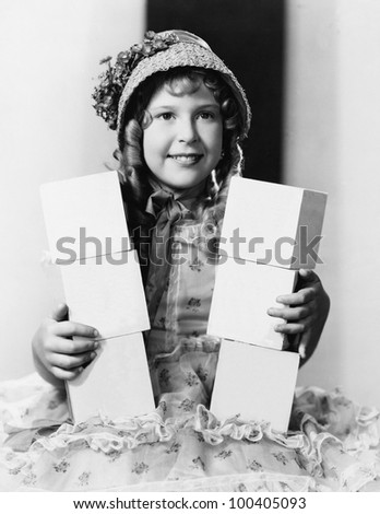 Girl with blocks spelling buy now - stock photo