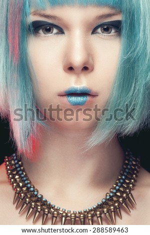 Girl with blue hair and fashion art make up. Studio shooting. Make up. Beauty and fashion - stock photo