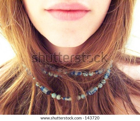 girl with blue necklace - stock photo