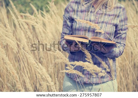 girl with book at the outdoor - stock photo