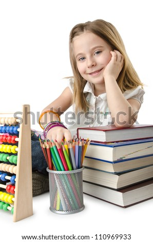 Girl with books and abacus - stock photo