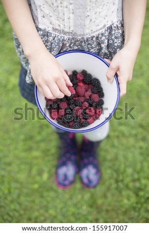 Girl With Bowl Of Freshl Wild Blackberries And Raspberries - stock photo