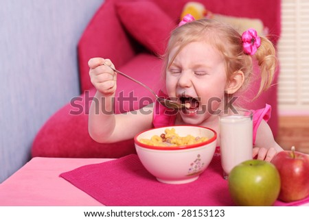 girl with breakfast - stock photo