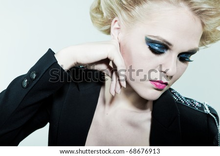 girl with bright makeup on eyes with his hands for the person - stock photo