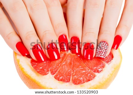 girl with bright red nail polish on the nails - stock photo