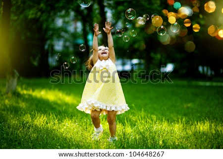 Girl with bubbles - stock photo