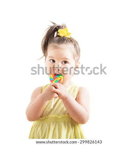 girl with candy isolated on white - stock photo