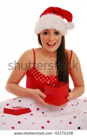 Girl with christmas gift in bed on white background - stock photo