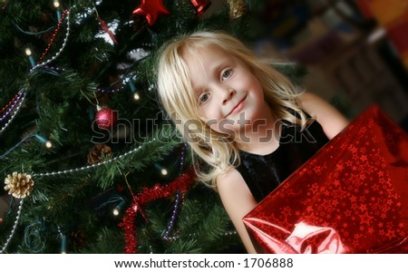 Girl with Christmas present - stock photo