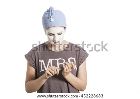girl with clay face mask  - stock photo