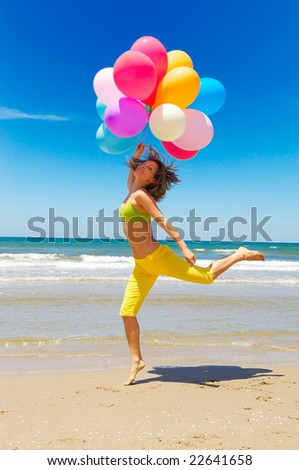 girl with colorful balloons on the beach - stock photo