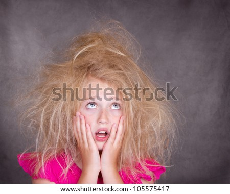 Girl with crazy bed head or tangled hair - stock photo