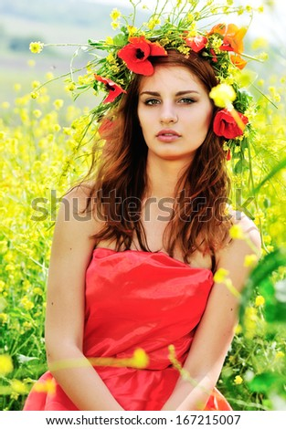 girl with crown from field'd flowers - stock photo
