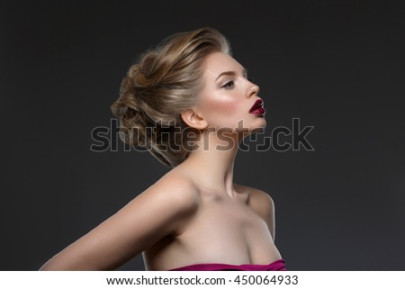 Girl with dark lips and hairdo - stock photo