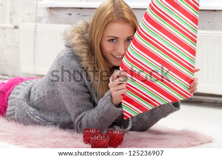 Girl with decoration paper preparing gifts - stock photo