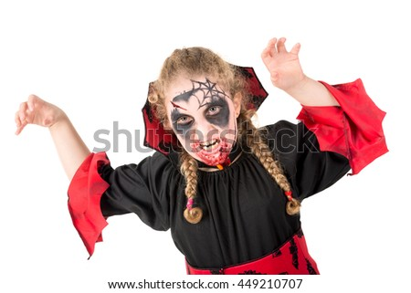 Girl with face-paint and vampire Halloween costume isolated in white - stock photo