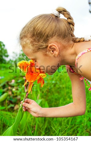 girl with flower in hand - stock photo