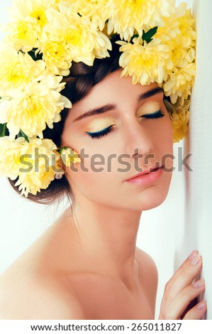 Girl with flower wreath. Caucasian woman with suntanned glowing skin and  brown hair close up. - stock photo