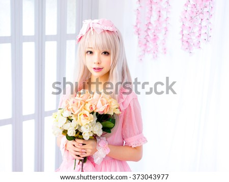 Girl with flowers pink princess dress  japanese style - stock photo