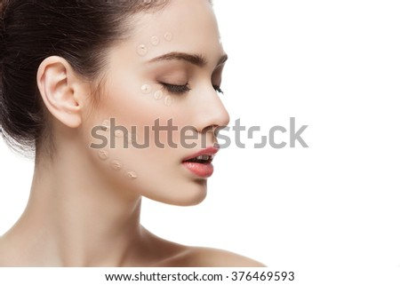 Girl with foundation cream on face - stock photo