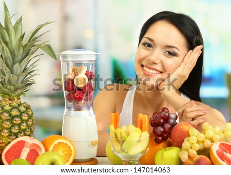 Girl with fresh fruits on room background - stock photo