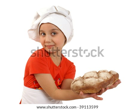 Girl with freshly baked loaf of bread - stock photo