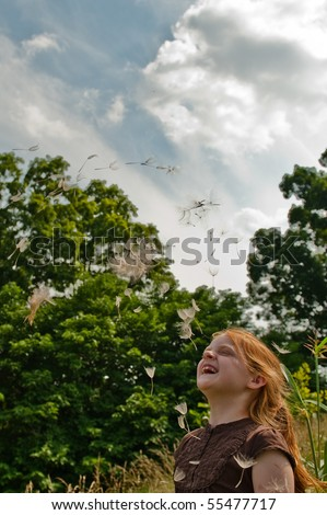 Girl with Giant Dandelion - stock photo