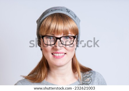 girl with glasses and gray cap - stock photo