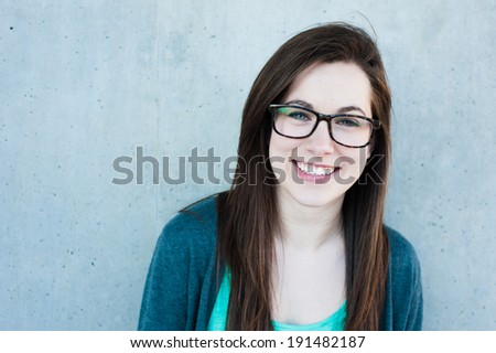 Girl with glasses smiling - stock photo