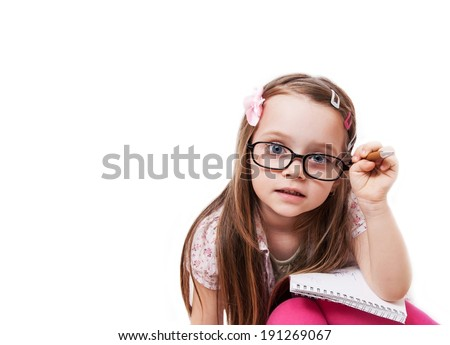 Girl with glasses who takes notes - stock photo