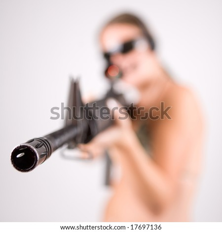 Girl with gun and glasses - stock photo