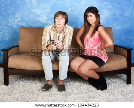 Girl with hand on hips next to distracted boyfriend - stock photo