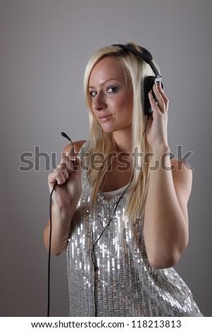 Girl with headphones - stock photo