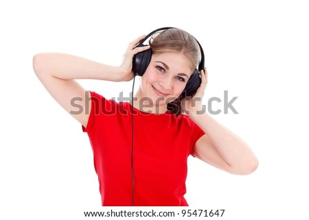 Girl with headphones listening music over white background - stock photo