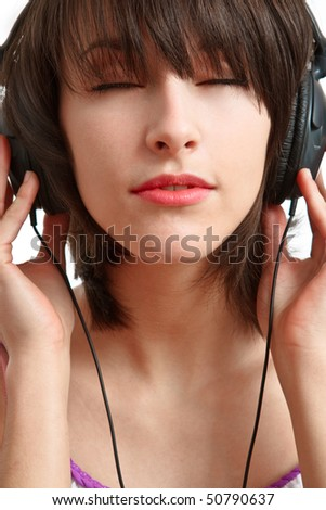 girl with headphones on - listening with pleasure - stock photo