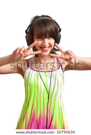 girl with headphones on - smiling and dancing - stock photo
