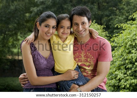 Girl with her parents - stock photo