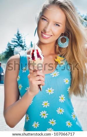 Girl with ice cream on the street - stock photo