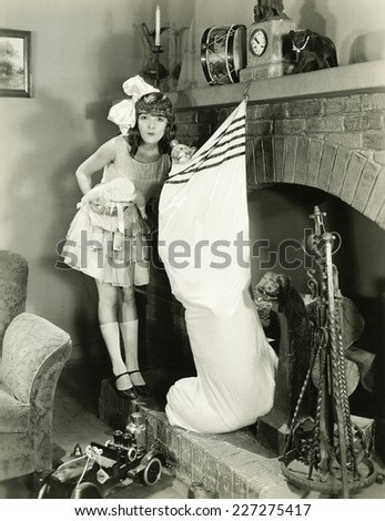 Girl with large Christmas stocking - stock photo