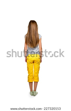 Girl with long flowing hair in a gray shirt and yellow trousers standing back to camera isolated on white background - stock photo
