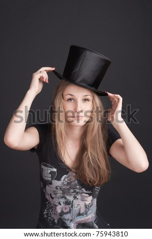 girl with long hair in a hat-cylinder - stock photo