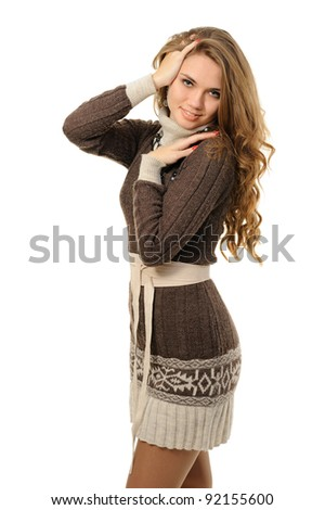 Girl with long hair in a warm dress - stock photo