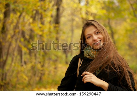 girl with long hairs looks at camera - stock photo
