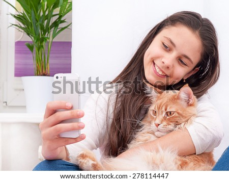Girl with Maine Coon cat - stock photo