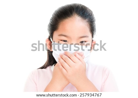 Girl with medicine protective masks isolated on white - stock photo